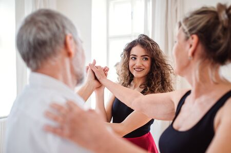 Senior couple in dancing class with dance teacher. Stok Fotoğraf - 124677485