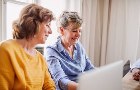 Senior women using laptops and tablets in community center club. Reklamní fotografie