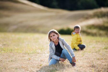 School children on field trip in nature, looking at camera. Zdjęcie Seryjne