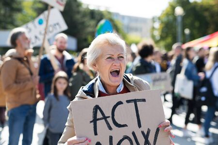 Senior with placard and poster on global strike for climate change, shouting. Reklamní fotografie