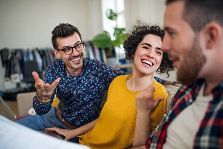 A group of young friends talking indoors at home, house sharing concept. Stock Photo