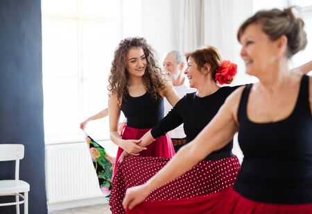 Group of senior people in dancing class with dance teacher. Stock Photo - 131323591