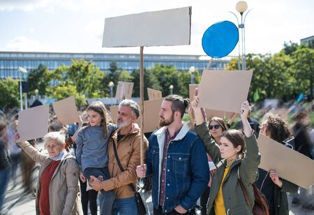 People with placards and posters on global strike for climate change.