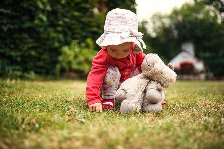 A front view of toddler girl outdoors in garden in summer. 版權商用圖片