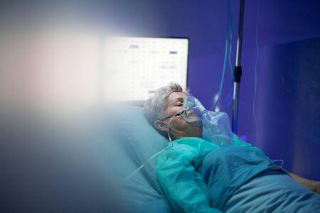 Infected patient in quarantine lying in bed in hospital, coronavirus concept. Reklamní fotografie