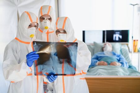 Medical team looking after infected patients in hospital, coronavirus concept.