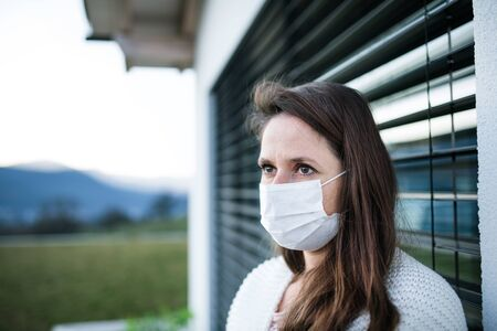Woman with face masks outdoors at home, Corona virus and quarantine concept. Stok Fotoğraf