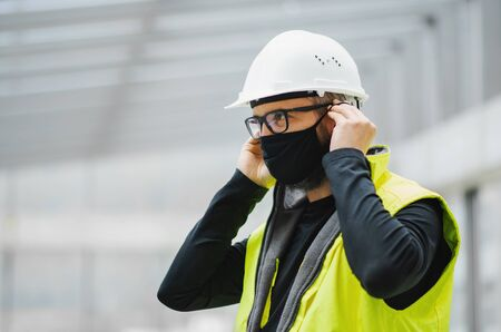 Portrait of worker with face mask at the airport.
