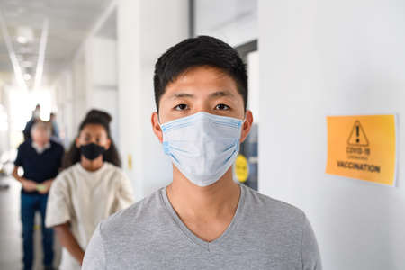 Portrait of people with face masks waiting, coronavirus, covid-19 and vaccination concept.