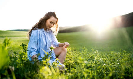 Portrait of young teenager girl outdoors in nature on meadow.