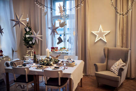 A table set for dinner meal at Christmas time. Stock fotó