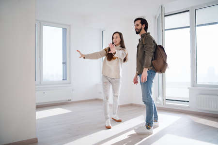 Young couple moving and planning in new flat, new home and relocation concept.