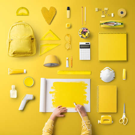 Flat lay top view of respirator and school supplies, back to school and concept. Standard-Bild