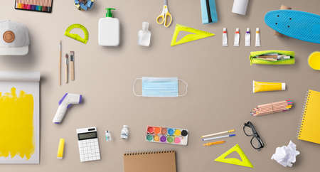 Flat lay top view of face mask and school supplies, back to school and concept.