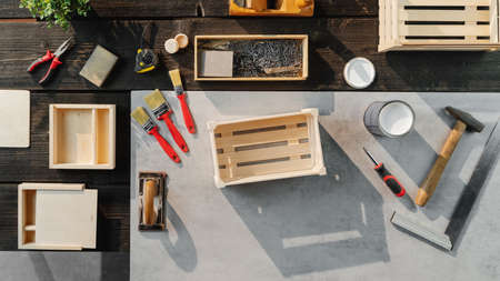Top view of group of tools for making wooden boxes, small business and desktop concept.