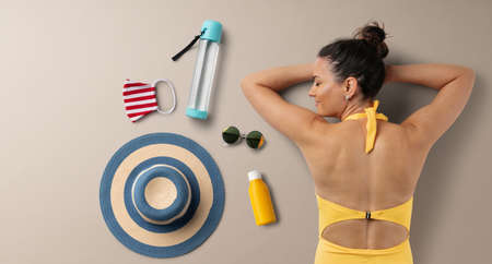 Flat lay top view of young woman with travel essentials, summer holiday concept.