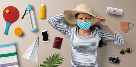 Flat lay top view portrait of young woman, summer holiday, coronavirus, travel and new normal concept.