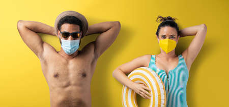 Flat lay top view portrait of young couple with face mask, summer holiday, coronavirus and travel concept.
