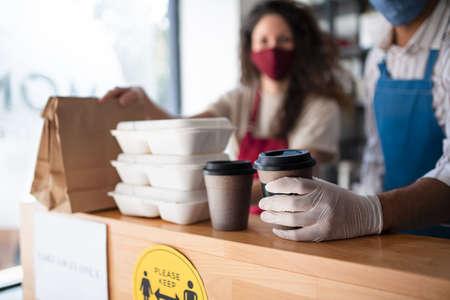 Waiters preparing take away order in coffee shop, virus concept.