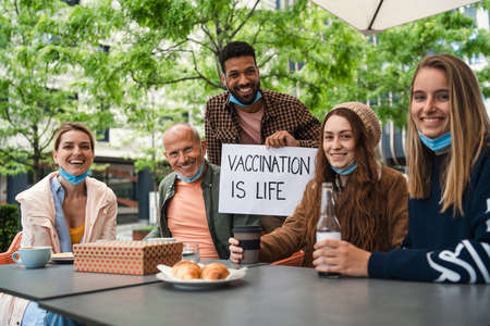 Reunion of family outdoors in city, life after  vaccination and back to normal concept.