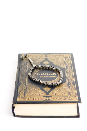kuran: Muslim holy book Quran is showed with tasbeeh on it. Stock Photo