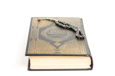 quran: Muslim holy book Quran is showed with tasbeeh on it. Stock Photo