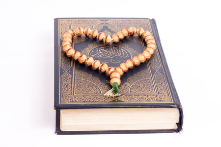 showed: Muslim holy book Quran is showed with tasbeeh on it. Stock Photo