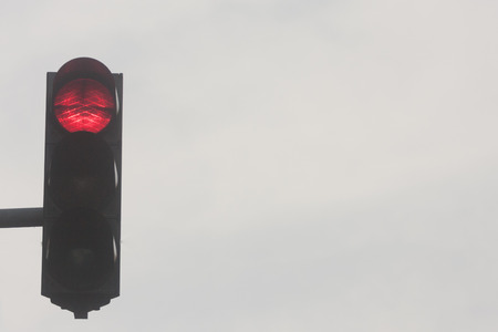 trafic: Traffic red light against sky, semaphore is showing red light
