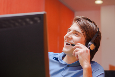 service desk: Portrait of call center agent at work in box office