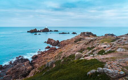 Corbiere Lighthouse sitting on an island just off Jersey in the Channel Islands