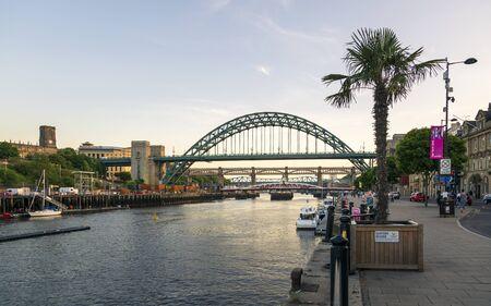 Newcastle, England - June 27 2018: Newcastle upon Tyne skyline, Gateshead with the Tyne Bridge over River Tyne, Tyne and Wear, Tyneside, England, United Kingdom, Europe Editorial