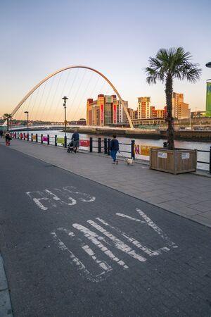 Newcastle, England - June 27 2018: Gateshead Millennium Bridge over River Tyne, Newcastle-upon-Tyne, Tyne and Wear, Tyneside, England, United Kingdom, Europe
