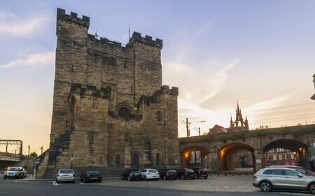 Newcastle, England - June 27 2018: The 12th century Norman Castle Keep, and the Lantern of the Cathedral Church of St. Nicholas, Newcastle upon Tyne, Tyne and Wear, England, United Kingdom, Europe Editorial