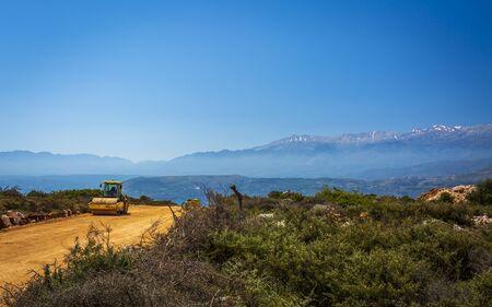 Crete, Greece - April 24 2018: Road roller building a road, Crete, Greek Islands, Greece Europe Éditoriale