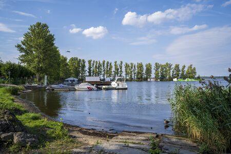 RIGA, LATVIA - AUGUST 16, 2019: Boats at Cabo Cafe in Kisezers lake, Mezaparks, Riga Latvia Europe