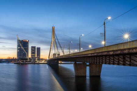 Illuminated Vansu Bridge over river Daugava
