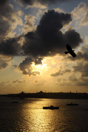 Istanbul Bosphorus and ship on sunset background photo