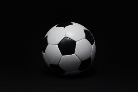 soccer background: soccer ball detail on black background