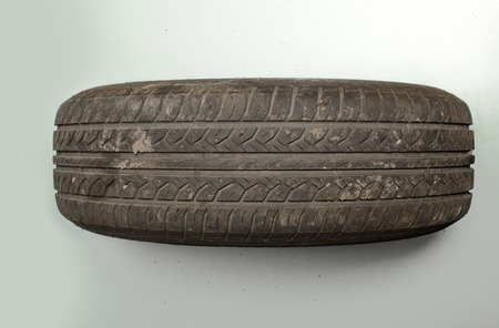 disposed: old car tire tread worn dirty