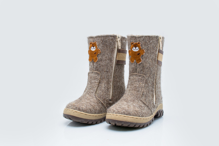 valenki: Childrens winter boots for snow Stock Photo
