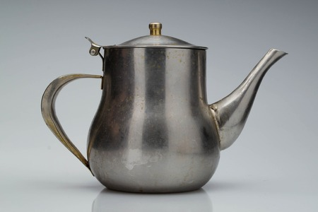 galvanized: Small classic kettle for camping isolated on white background Stock Photo