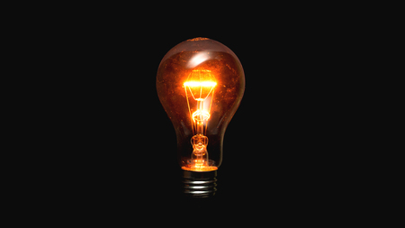 Light bulb on a black background