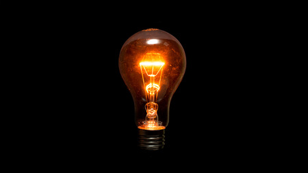 Light bulb on a black background