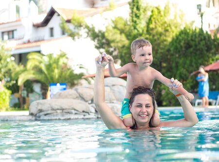 Joyful mother with a baby bathe