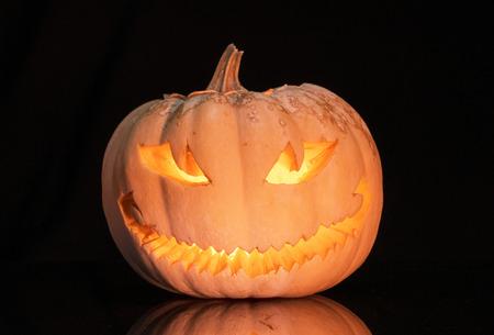 Scary pumpkin on black background