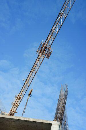 Reinforcement and concrete against the sky. Monolithic building construction. the arrow of the crane runs diagonally