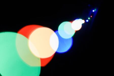 Bokeh of colored lights. colored lights on a black background