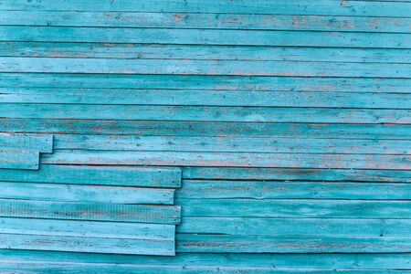 Boards are blue. Texture of an old wall made of parallel planks.