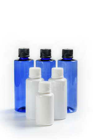 Composition with cosmetic products on a white background. Containers for cosmetics in white and blue.