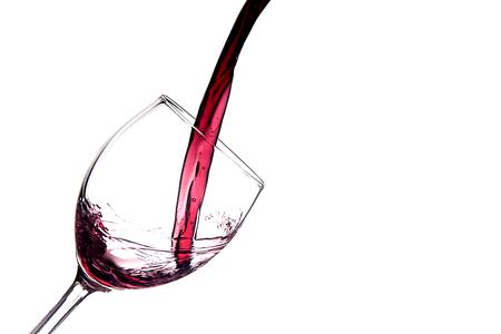 Glass of spilled wine splashing out Zdjęcie Seryjne - 119434299